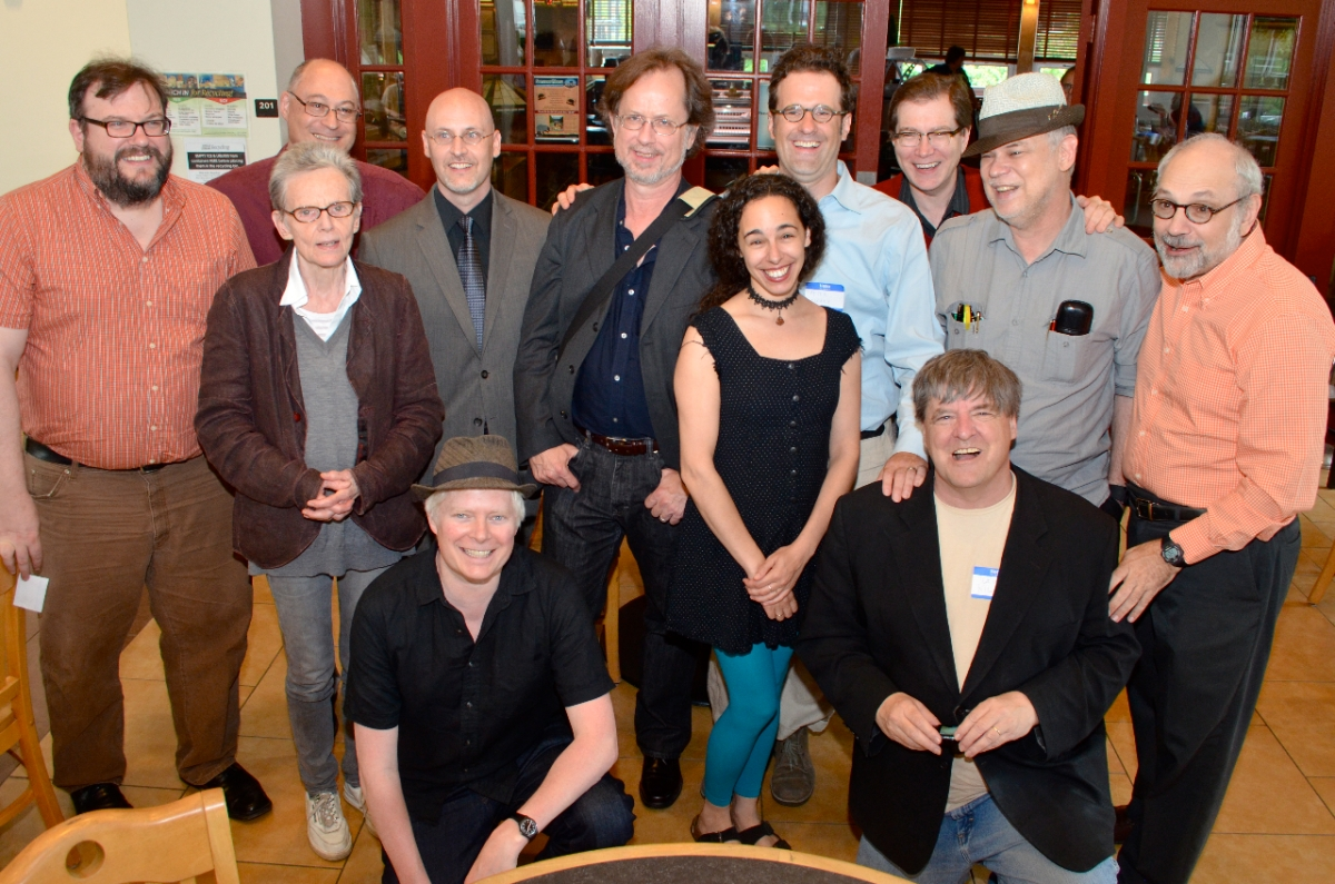 From L to R: John Beer, Susan Howe, Norman Finkelstein, Richard Deming, Lytle Shaw (kneeling), Patrick Pritchett, Robin Brox, Peter O'Leary, Joe Donahue, Kevin Killian (kneeling), Aldon Nielsen, and Charles Bernstein.