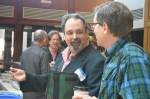 Joseph Donahue (in profile) talking with Robert Archambeau.  Photo (c)2012 by Star Black.